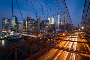 Traffic on the Brooklyn bridge with Lower Manhattan city skyline in the background