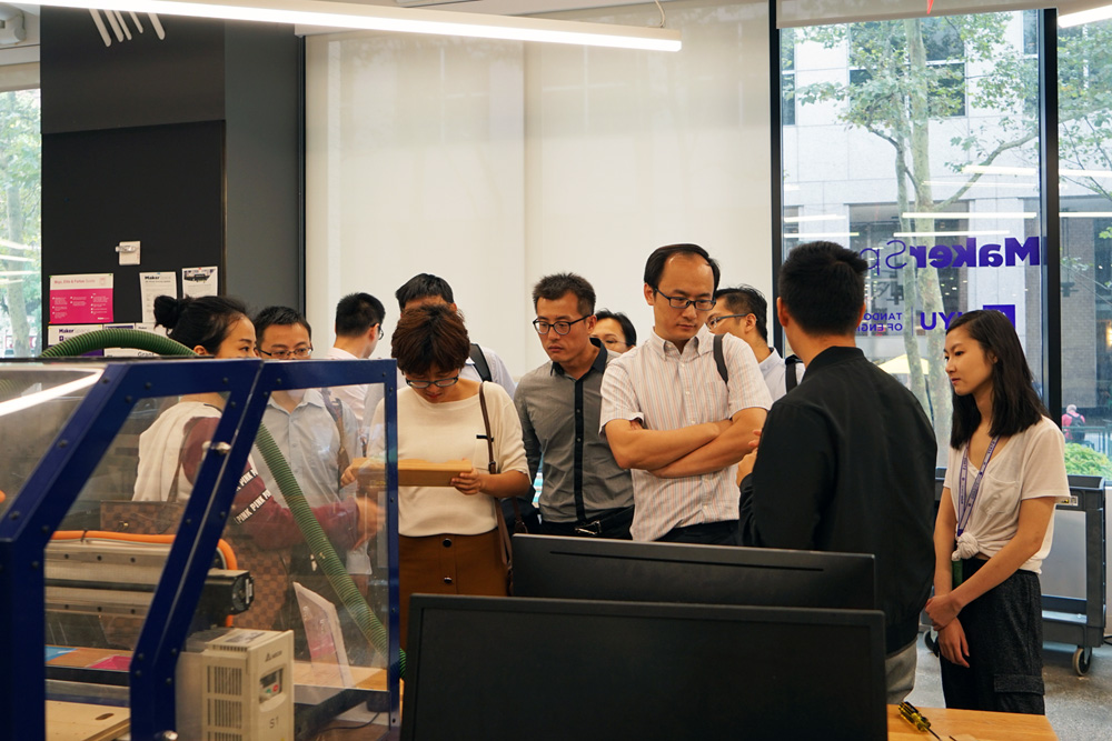 Students give the delegation from Tianjin Municipal Engineering Design & Research Institute a tour of the MakerSpace.