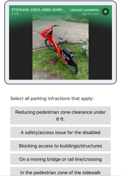 Photogaph of an app showing a bicycle and a selection of infractions to choose from
