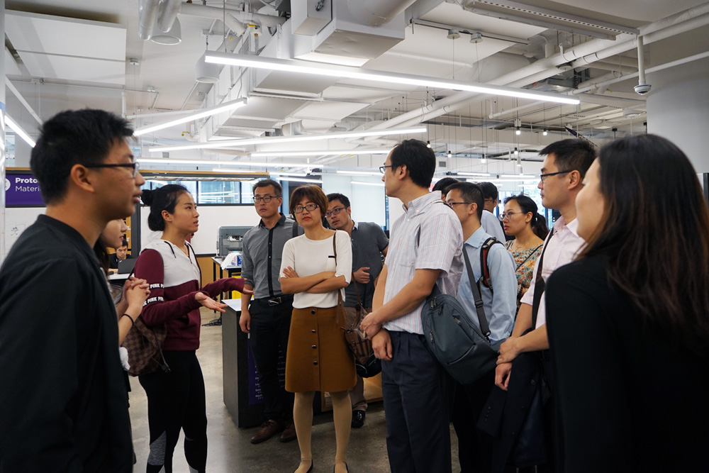 Students give the visiting delegation from Tianjin a tour of the MakerSpace.